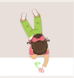 little girl lying on her stomach and drawing vector image vector image