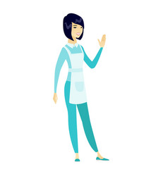 Young asian cleaner waving her hand vector