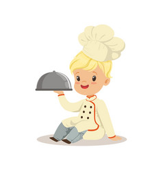 Cute little boy holding a silver cloche food vector