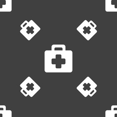 First aid kit icon sign seamless pattern on a gray vector