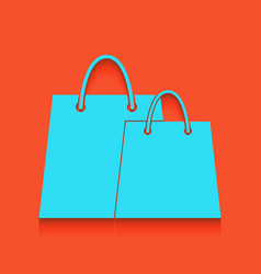Shopping bags sign whitish icon on brick vector