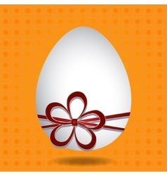 Easter egg with a red bow vector