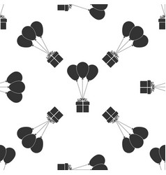 Gift box with balloons icon seamless pattern vector