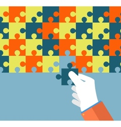 Businessman assembling jigsaw puzzle vector