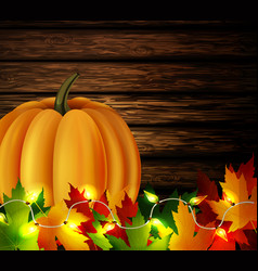 Autumn leaves and pumpkin on wooden texture vector