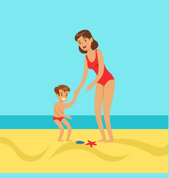 Mother with her son walking on a beach vector