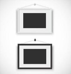 Blank picture frame set hanging on wall vector