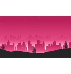 Silhouette of building from hill vector