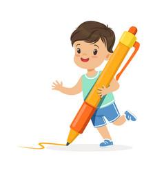 cute little boy holding giant orange pen cartoon vector image vector image