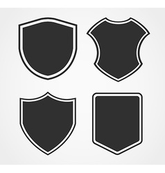 Black shield icon set with different shapes vector