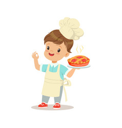 cute little boy holding a freshly cooked pie vector image