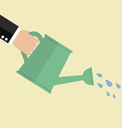 Hand holding watering can vector image