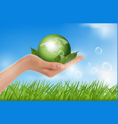 human hand holding green globe vector image