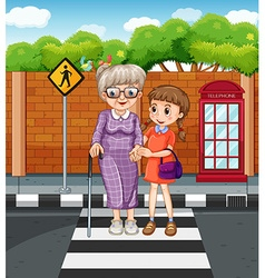 Girl helping grandmother crossing the street vector image
