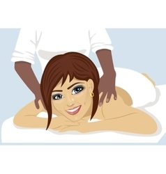 happy woman receiving back massage at salon spa vector image vector image