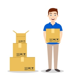 Young smiling delivery service man holding boxes vector