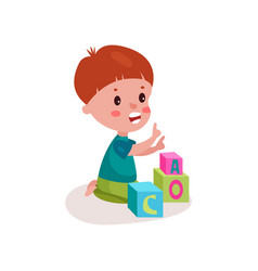 cute redhead little boy sitting on the floor vector image
