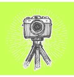Single-lens reflex camera on tripod vector