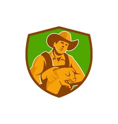 Pig farmer holding piglet front shield retro vector