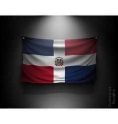 Waving flag dominican republic on a dark wall vector