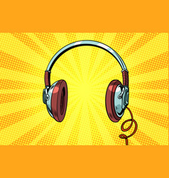 Retro headphones on a yellow background vector