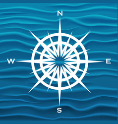 Wind rose over blue waves background vector