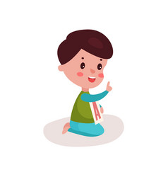 cute little boy sitting on the floor playing with vector image