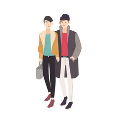 pair of young men dressed in trendy outerwear vector image vector image