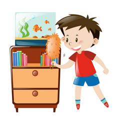 Boy dusting shelf and fishtank vector