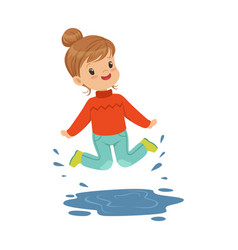 cute happy little girl playing on a puddle wearing vector image