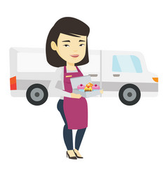 Delivery woman holding a box of cakes vector