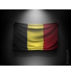Waving flag belgium on a dark wall vector