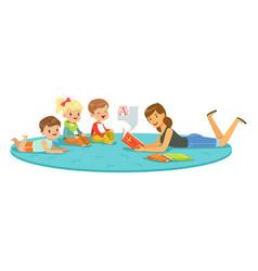 teacher reading a book to kids children enjoy vector image
