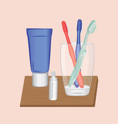 a glass and toothbrushes vector image
