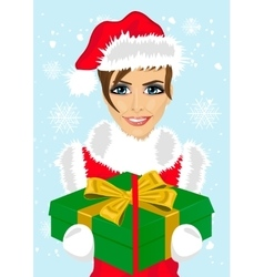 woman in christmas santa hat holding gift box vector image