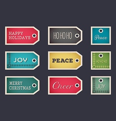 Christmas holiday gift tags set on dark backgroud vector image