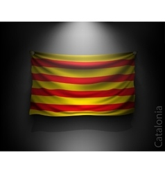Waving flag catalonia on a dark wall vector