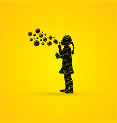 A little girl blowing soap bubbles graphic vector