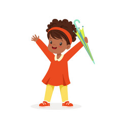 cute happy black little girl standing and holding vector image