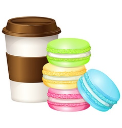 Coffee cup and colorful macaron vector image