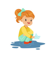 Sweet little girl playing with paper boat in a vector
