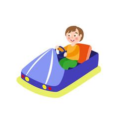 Boy driving bumper car from amusement park vector