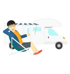 Man sitting in front of motorhome vector