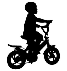 Boy riding bicycle vector