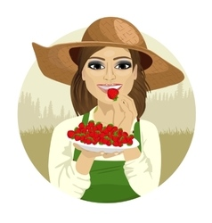 Young woman tasting berry vector