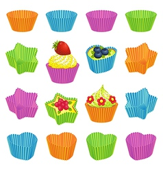 Cupcakes and colourful baking cups vector image