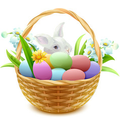 Wicker basket with easter eggs flowers and bunny vector