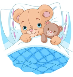 Cute baby bear in bed vector