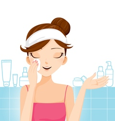 Young woman cleaning makeup on her face vector