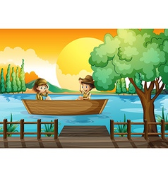 A boy and a girl at the boat vector